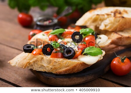 Bruschetta with olive and garlic pesto, with cherry tomato and p Stock photo © boggy
