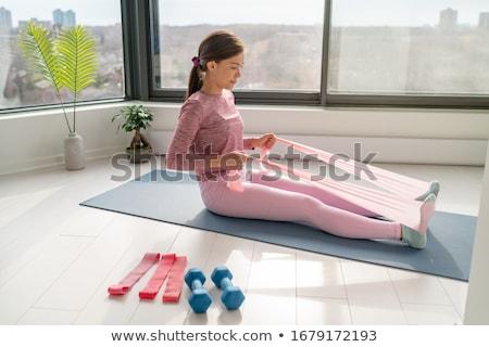Resistência banda casa fitness exercício mulher Foto stock © Maridav