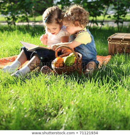 gülen · aile · iki · kitap · çocuk - stok fotoğraf © dashapetrenko