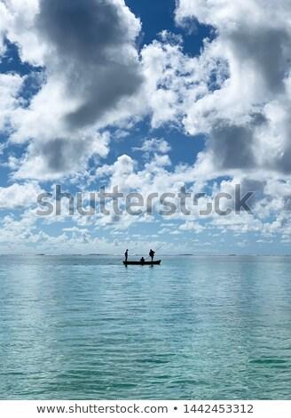 Küçük gemi insanlar yüzme deniz gün batımı Stok fotoğraf © Borissos