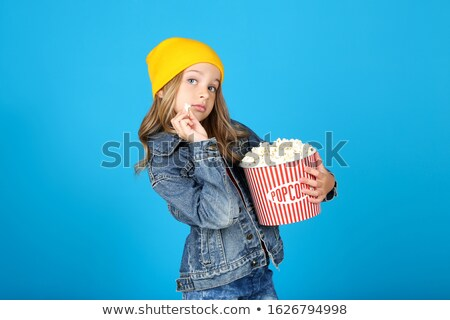 Happy little girl with popcorn Stock photo © lightkeeper