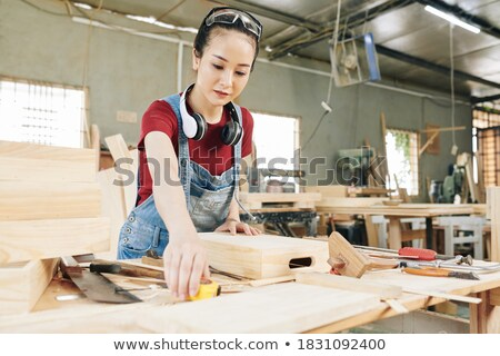 A female carpenter taking measures. Stock photo © photography33