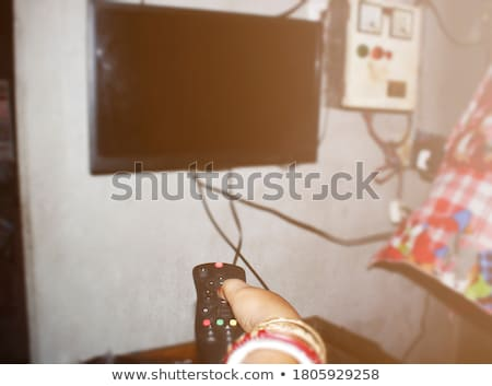A couple repairing the TV. Stock photo © photography33