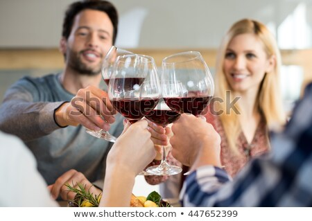 Men raising their glasses in a toast Stock photo © photography33