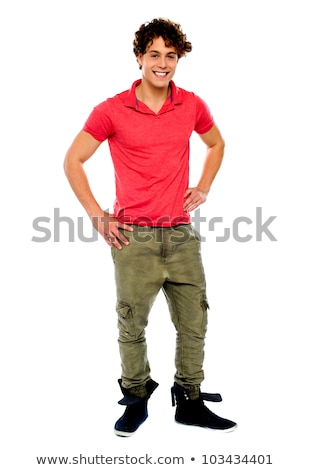 Casual guy posing, hands on his waist Stock photo © stockyimages