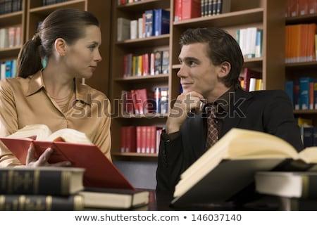 Casal biblioteca amor telefone espaço Foto stock © photography33