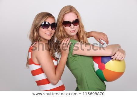 Dois adolescentes óculos de sol bola de praia Foto stock © photography33