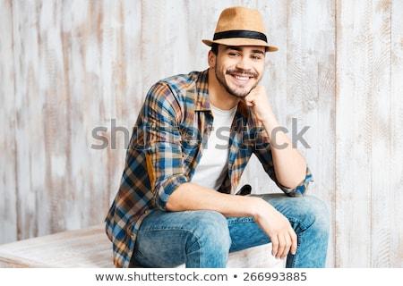 笑みを浮かべて マッチョ 男 着用 帽子 ストックフォト © feedough