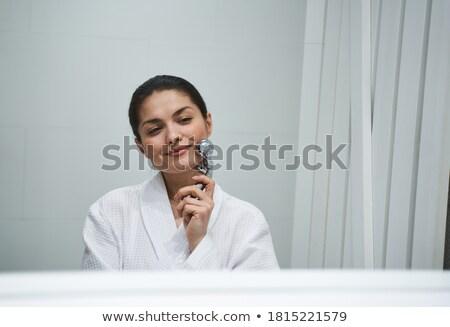 Dark-haired woman enjoying the procedure of massage Stock photo © wavebreak_media