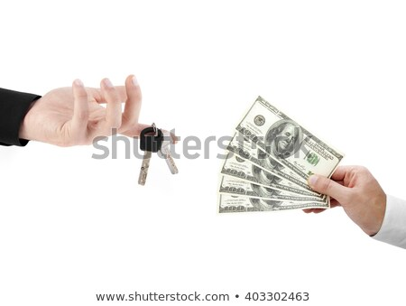 hands holdind money and car keys stock photo © shutswis