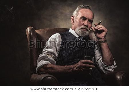 Portré férfi szivar sötét tűz divat Stock fotó © OleksandrO