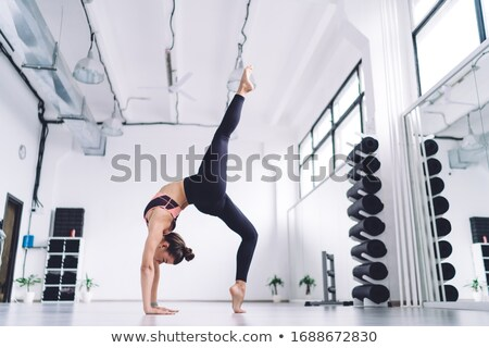 Shaping. Fitness. Active Shapely Woman in Sportswear on Tiptoe. Wellbeing Stock photo © gromovataya