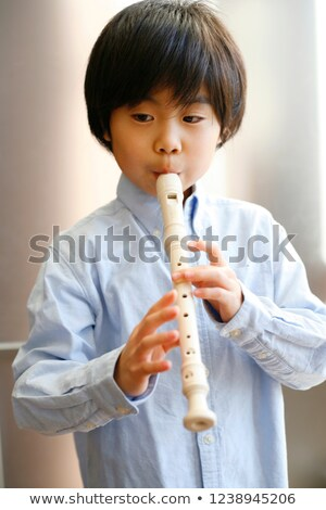 Young kid playing recorder Stock photo © bogumil