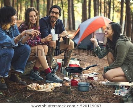 barátok · tábortűz · férfi · női · vakáció · férfi - stock fotó © luminastock