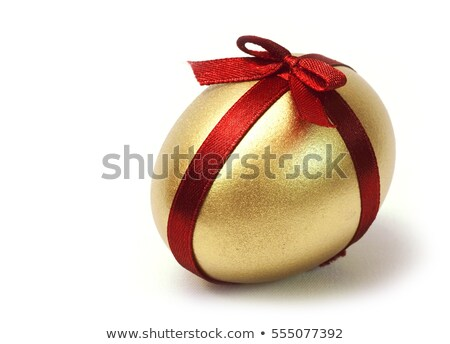 Gold egg with red bow isolated on white background. Stock photo © Leonardi