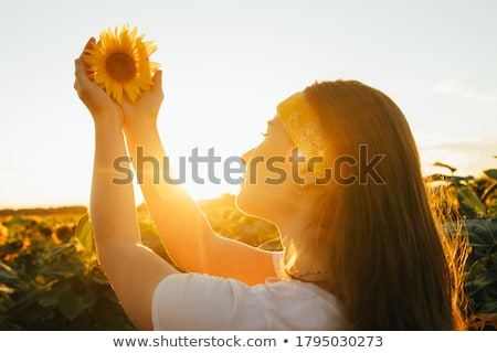 flower woman holding sunflower smiling happy stock photo © maridav