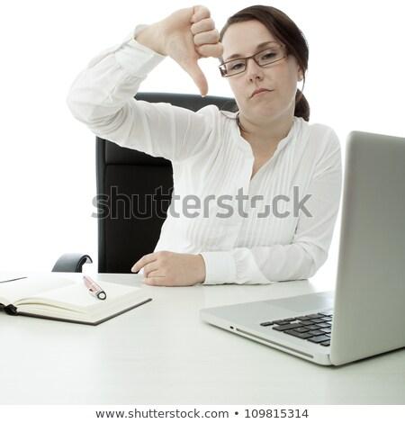 молодые брюнетка деловая женщина очки столе большой палец руки Сток-фото © sebastiangauert