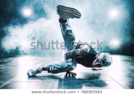 Hip hop, break dance performed by young man in colorful club lights Stock photo © photocreo
