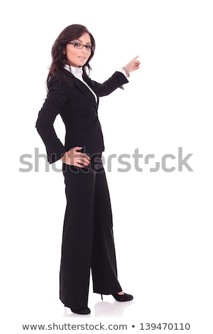 Young woman standing with her hand on hip and pointing Stock photo © bmonteny