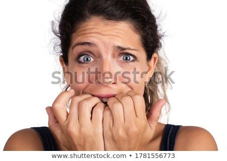 young woman biting fingernails stock photo © bmonteny