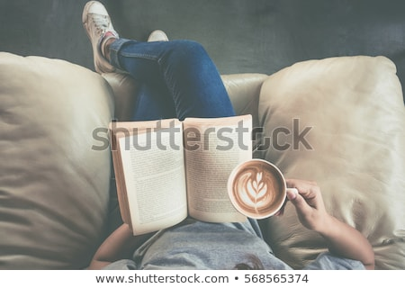 beautiful young girl reading a tablet in bed stock photo © dash
