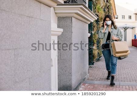 smiling blond female talking through phone stock photo © dash