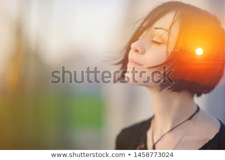 profile of pensive woman with closed eyes stock photo © gromovataya