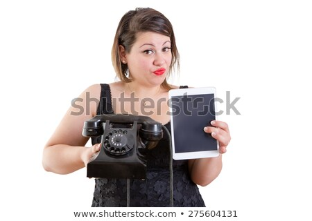 Charismatic woman comparing old and modern devices Stock photo © ozgur