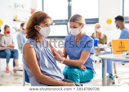 ストックフォト: 医師 · シリンジ · 腕 · クローズアップ · 注入 · 手