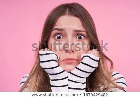 Blonde woman holding one finger near her mouth  Stock photo © feedough