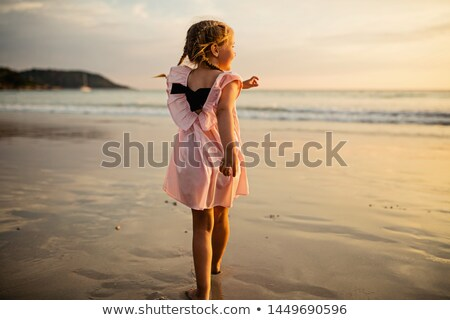 Happy family with little girl walk on beach in evening, having j stock photo © Paha_L