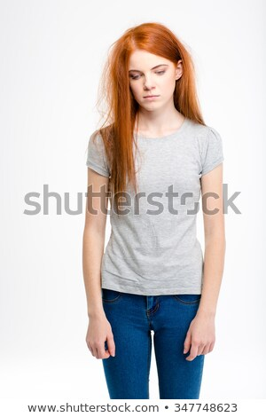 Portrait of sad exhausted young girl with long tousled hair  Stock photo © deandrobot