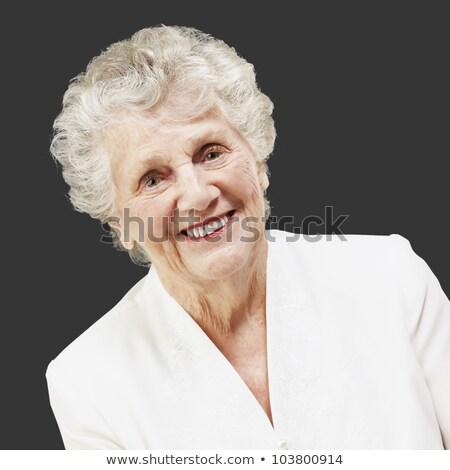 Kegyelmes idős nő megnyugtató otthon elegáns Stock fotó © ozgur