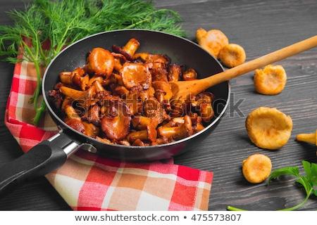 delicious roasted chanterelles stock photo © zhekos