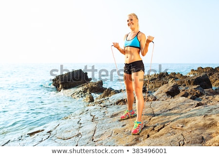 Athlète femme sport roches mer Photo stock © vlad_star