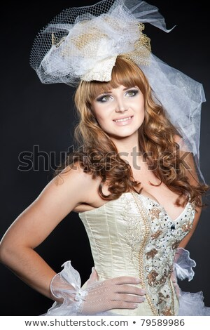 close up shot of beautiful girl in white corset with golden patt stock photo © elisanth