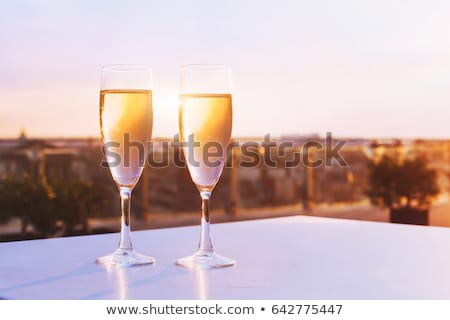 close up of champagne and glasses at restaurant stock photo © dolgachov