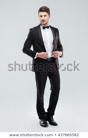 Aantrekkelijk jonge man smoking permanente gezicht Stockfoto © deandrobot