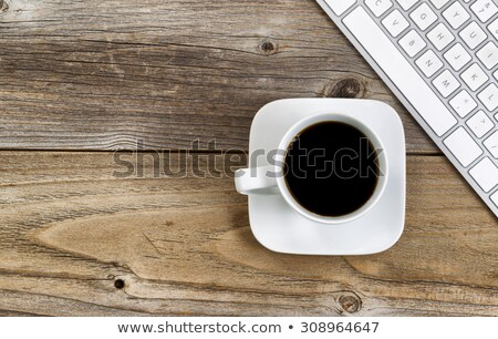 Black coffee with partial computer keyboard for school or office Stock photo © tab62