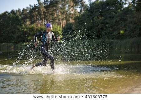 Girl in the swimrun suit outdoors Stock photo © bezikus