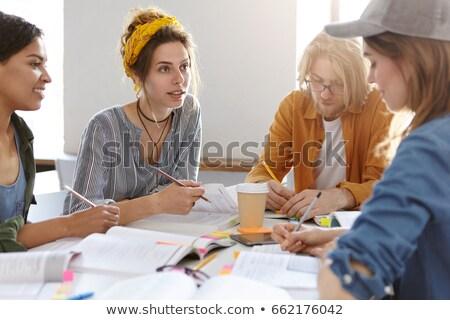 Quattro persone iscritto bianco pen matita sfondo Foto d'archivio © bluering