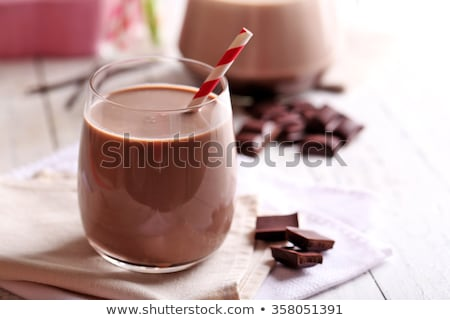 Glass of cocoa with milk. Chocolate milkshake Stock photo © orensila
