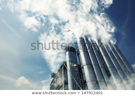 polluted smoke against a clear blue sky from the tall chimney Stock photo © Klinker