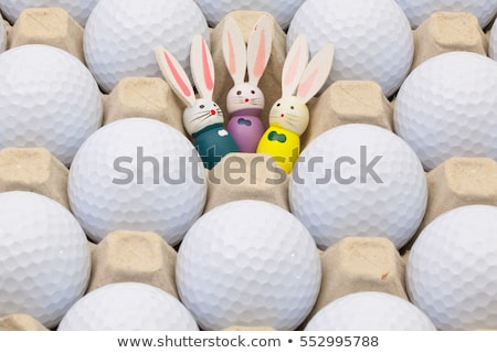 Golf balls in the box for eggs and Easter decoration Stock photo © CaptureLight