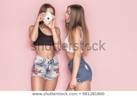 Fashion photo of attractive caucasian twins sisters posing in pi Stock photo © NeonShot
