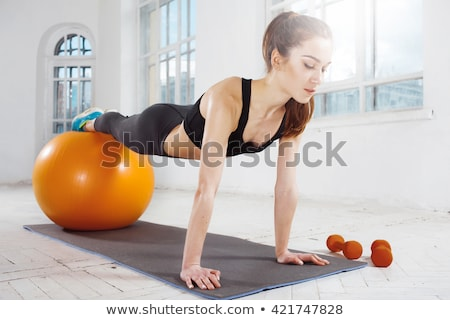 beautiful slim woman doing some gymnastics at the gym stock photo © master1305