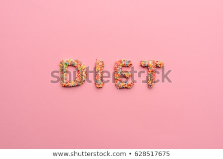 Close-up view of word diet made from sweets isolated on pink, healthy living concept  Stock photo © LightFieldStudios