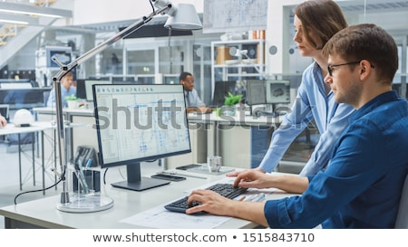 construction engineer working on desktop computer using cad soft stock photo © stevanovicigor