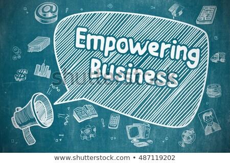 empowering business concept doodle icons on chalkboard stock photo © tashatuvango