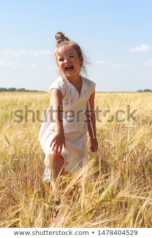 Girl shouting in the wheat field Stock photo © lightkeeper